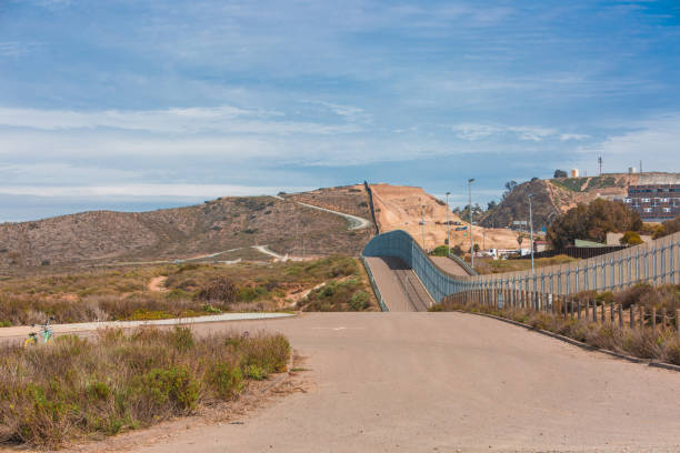Border wall along the Mexico and USA side, from Mexico stock photo