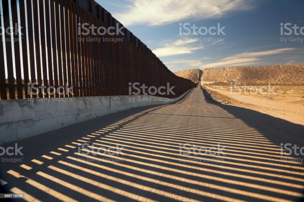 U.S. Border Wall Fence Fence separating United States and Mexico Barricade Stock Photo