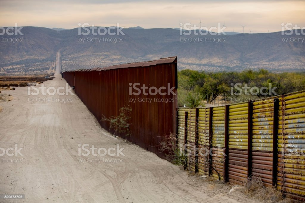 Border Wall Section Between United States and Mexico A lengthy section of the United States border wall with Mexico in California Baja California Peninsula Stock Photo