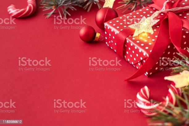 Border with branches sprucechristmas red balls and gift box on a red picture id1183586612?b=1&k=6&m=1183586612&s=612x612&h=jo6jmwccktkj9wlmzz0ipozlitocsubaa9sperx1xle=