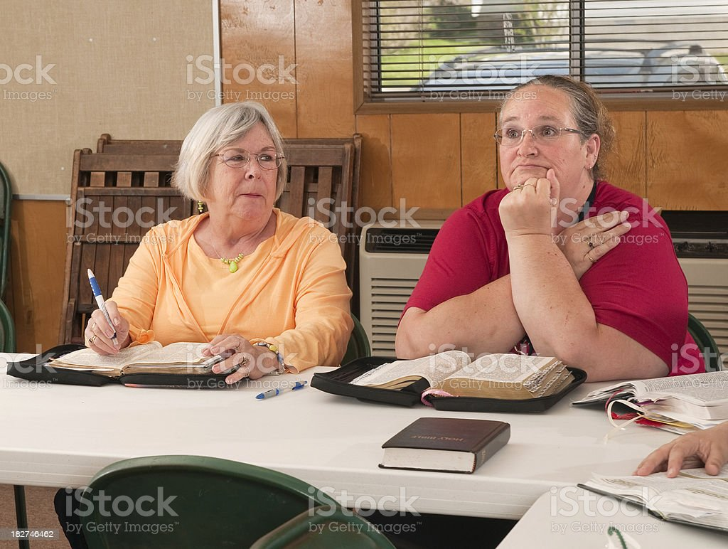 Bored and Distracted at Bible Study stock photo
