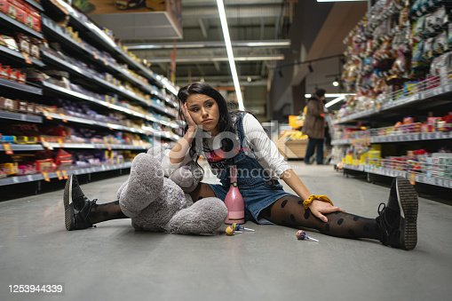 926078666 istock photo Bored and lonely birthday girl at the super market 1253944339