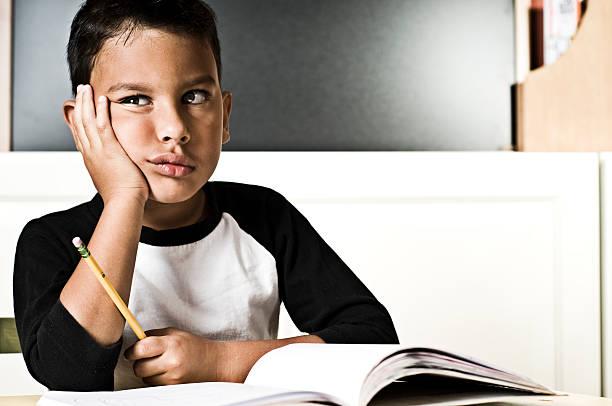 Bored Boy Doing Homework stock photo