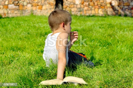 istock bored boy with book 153676612