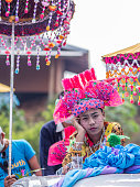 istock Bored boy with the traditional Tai Yai costume in the Poi Sang Long parade. 1313196104