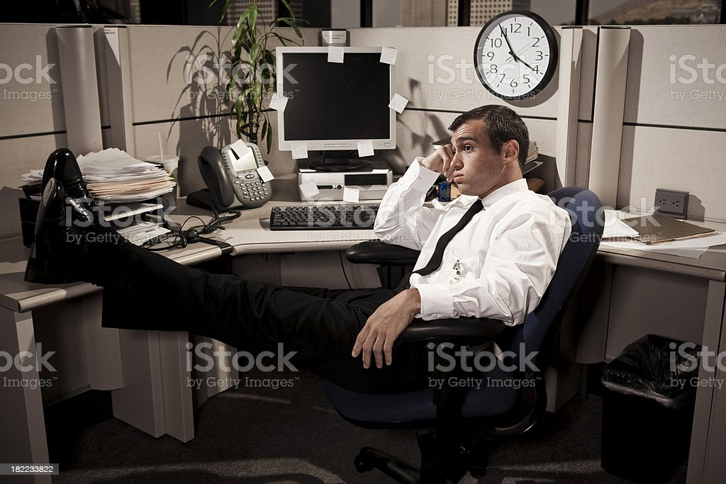 Bored Business Man in Office Cubicle royalty-free stock photo