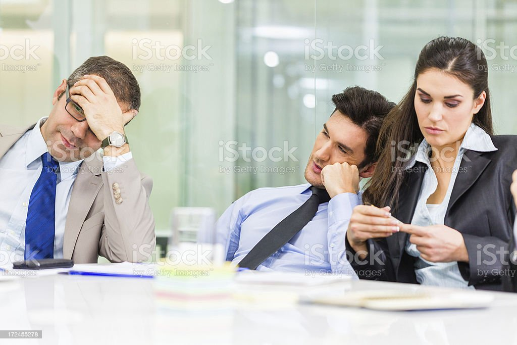 Bored business people at the office stock photo