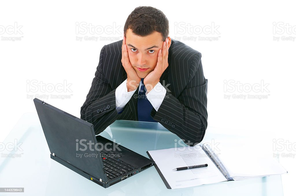 Bored businessman with laptop royalty-free stock photo