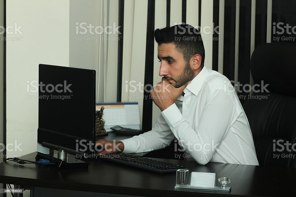 bored businessman working on computer in office stock photo more