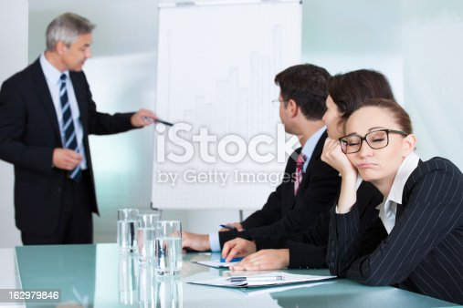 istock Bored businesswoman sleeping in a meeting 162979846