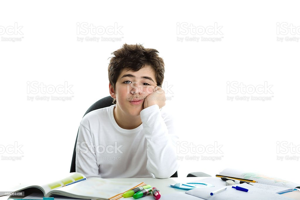 bored Caucasian smooth-skinned boy holds chin resting his elbow stock photo
