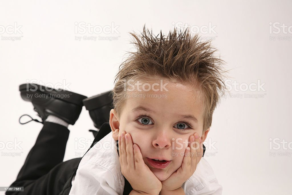 Bored Cute Boy holding Head Up with Hands on Face royalty-free stock photo