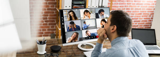 Bored Employee In Video Conference stock photo