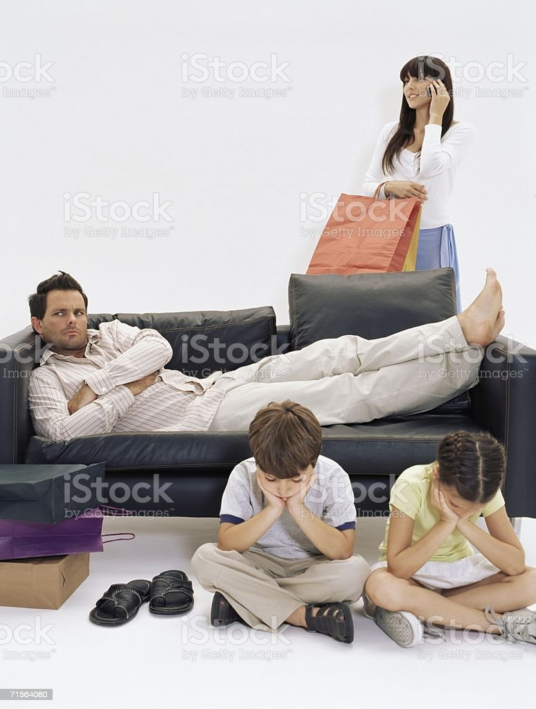 Bored family waiting for mother royalty-free stock photo
