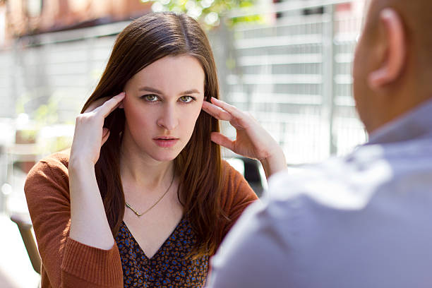 Bored Female on an Outdoor Date Being Rude stock photo