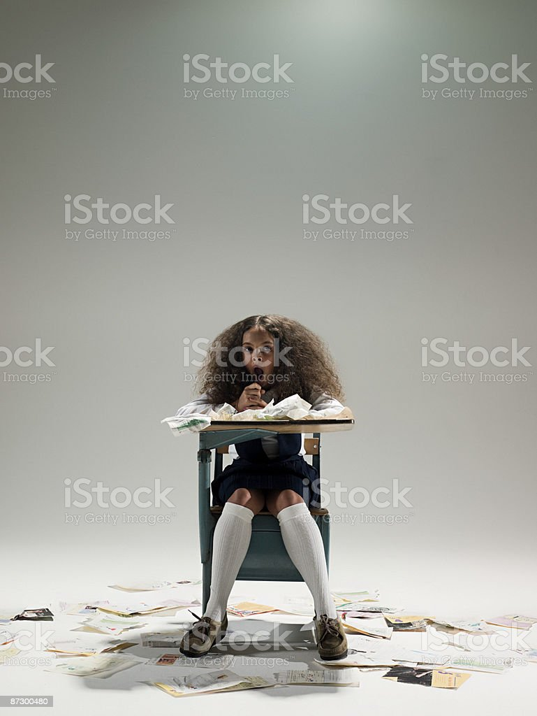 Bored girl at desk royalty-free stock photo