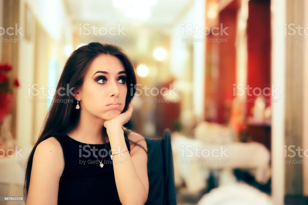 Bored Girl Having No Fun at Fancy Party stock photo