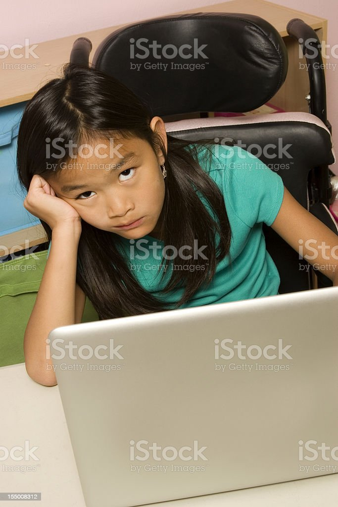 Bored girl infront of laptop computer royalty-free stock photo