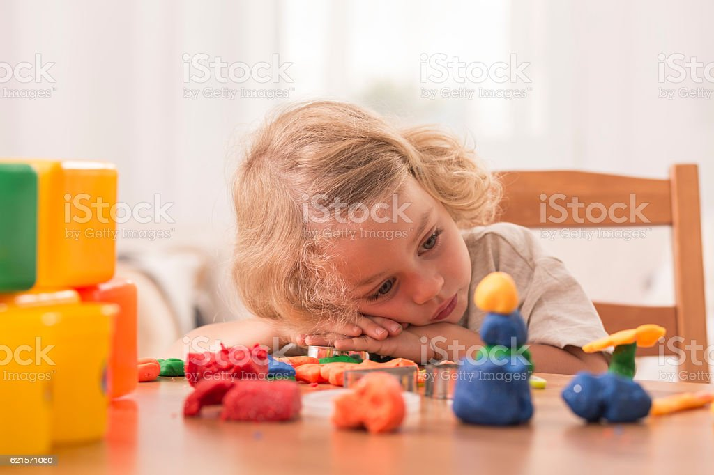 Bored girl with plasticine toys photo libre de droits