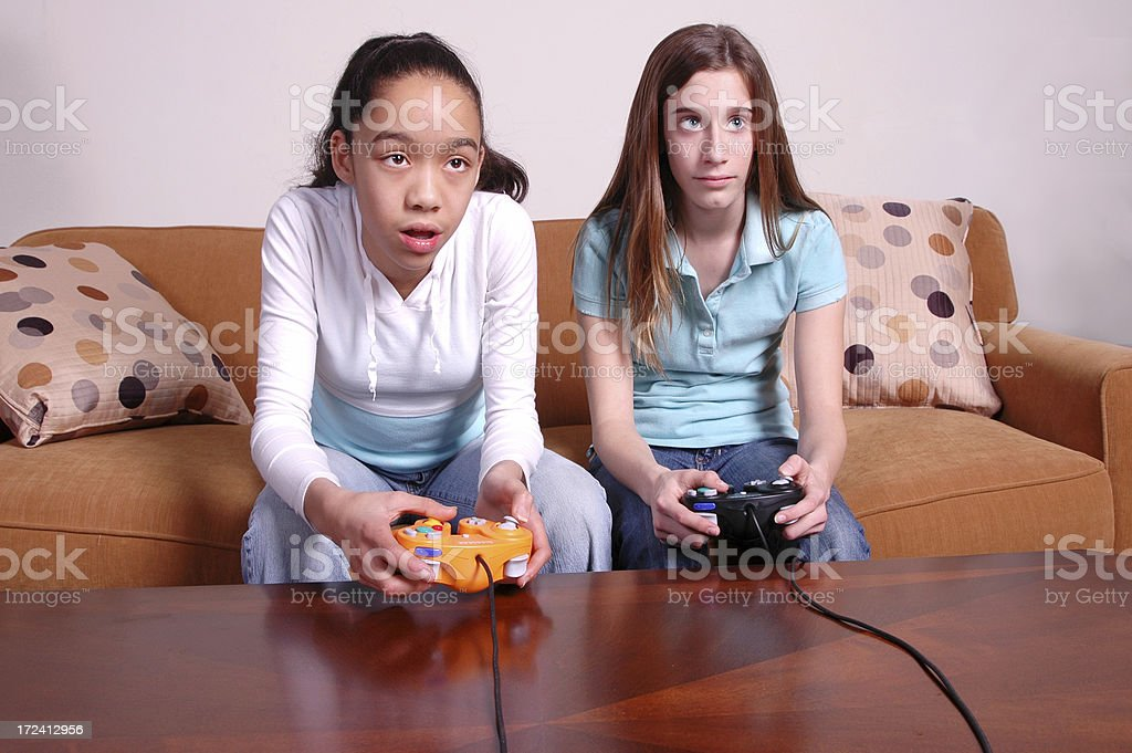 Bored Girls Playing Video Games Stock Photo - Download Image