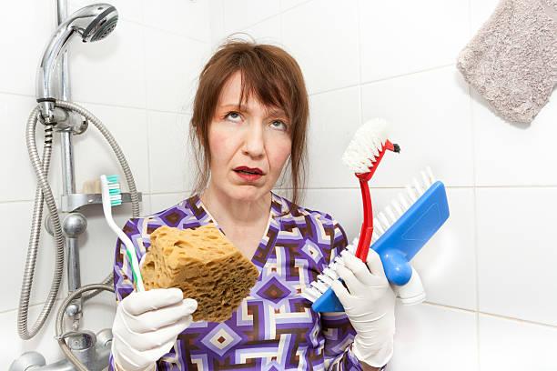 bored housekeeper stock photo