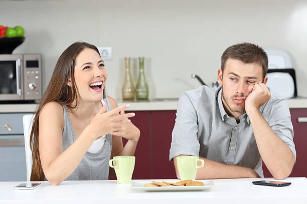 bored husband hearing his wife talking - 異性情侶 個照片及圖片檔