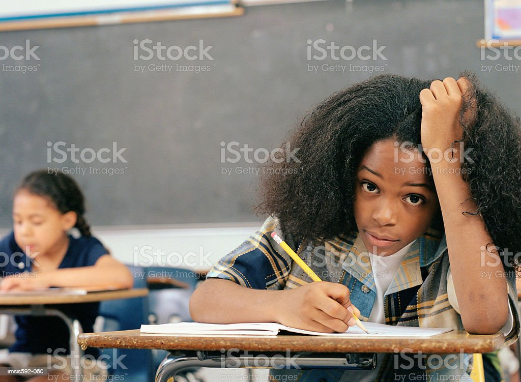 Bored looking boy in classroom royalty-free stock photo
