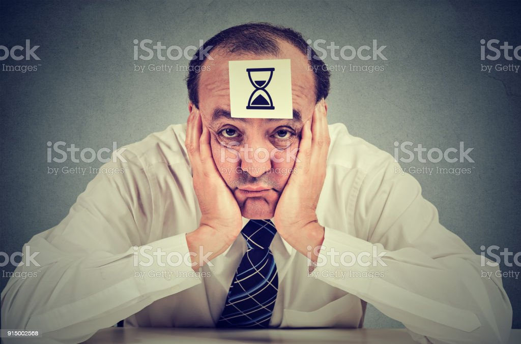 Bored man being lazy at work stock photo
