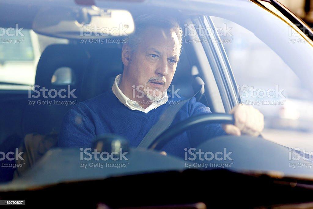 Bored man driving his car stock photo