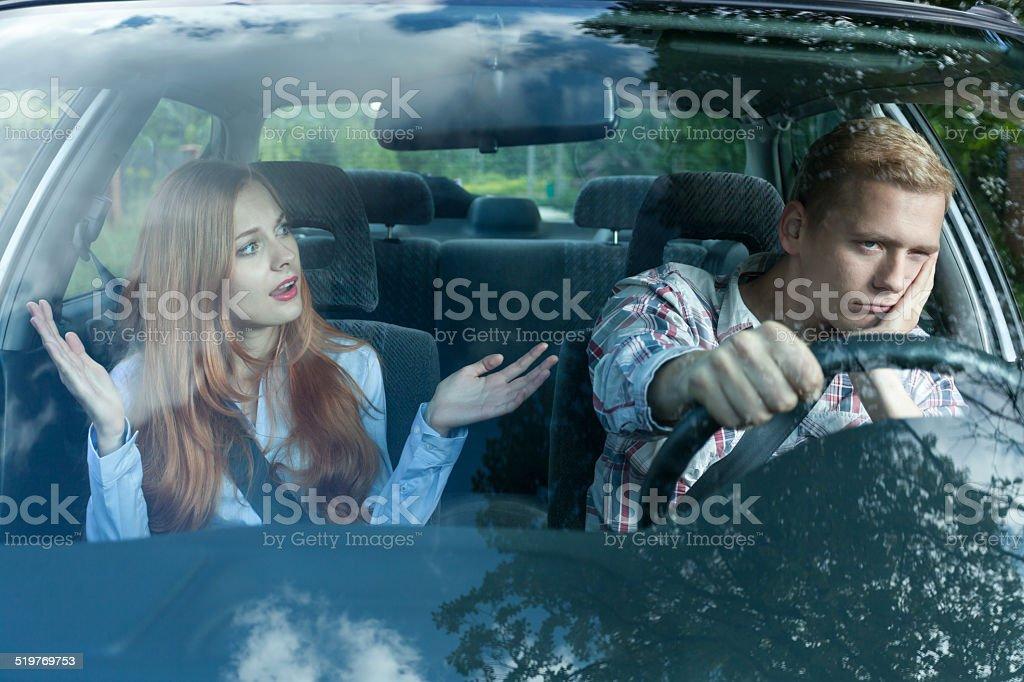 Bored man in a car stock photo