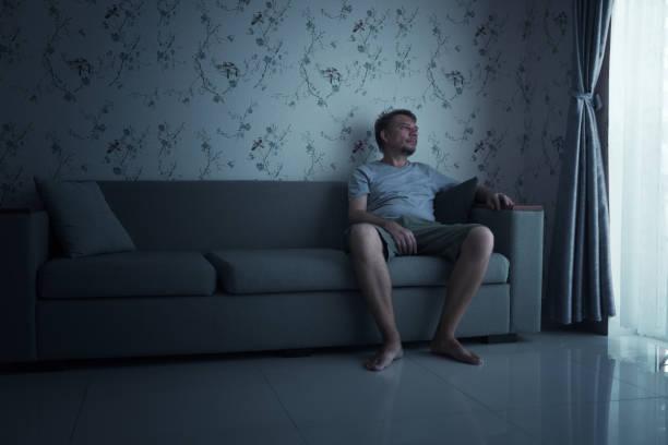 Bored Man sitting on sofa at Quarantine
