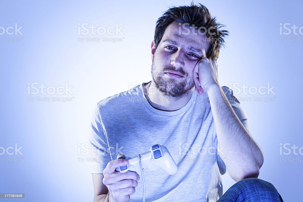 Bored Man with Gamepad royalty-free stock photo