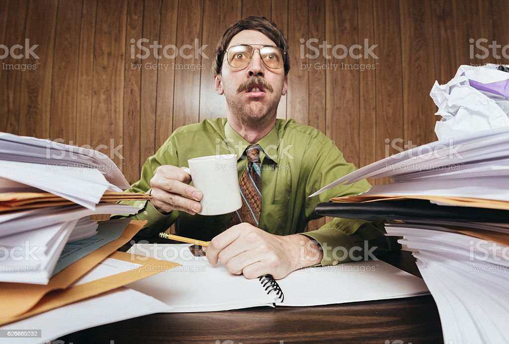 Bored Office Worker with Cluttered Desk stock photo