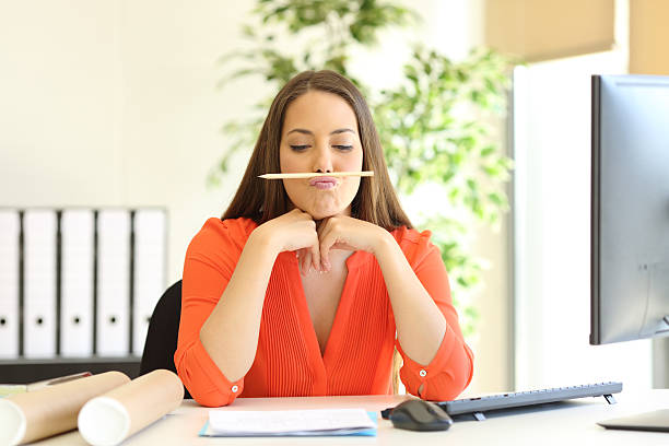 bored or incompetent businesswoman at work - laziness stock photos and pictures