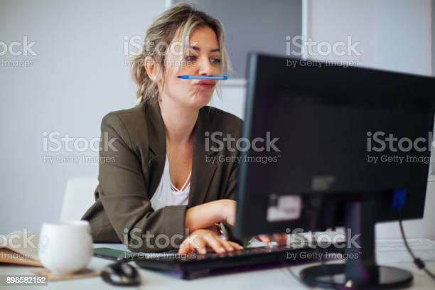 Bored or incompetent businesswoman at work picture id898582152?b=1&k=6&m=898582152&s=612x612&h=aizlw cdw20ymppyjt5fpsadmeoruc8inikoymavqrs=