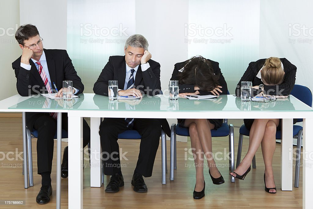 Bored panel of judges or interviewers royalty-free stock photo
