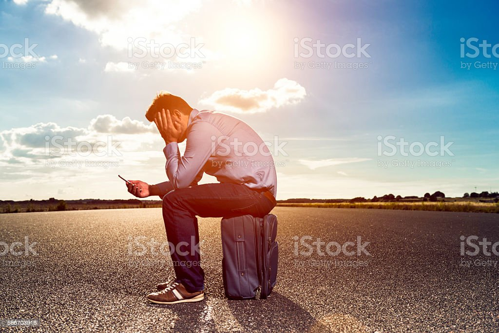 Bored passenger is stranded while waiting for airplane stock photo