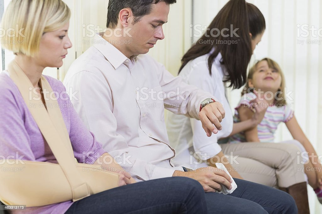 Bored patients in the waiting room stock photo