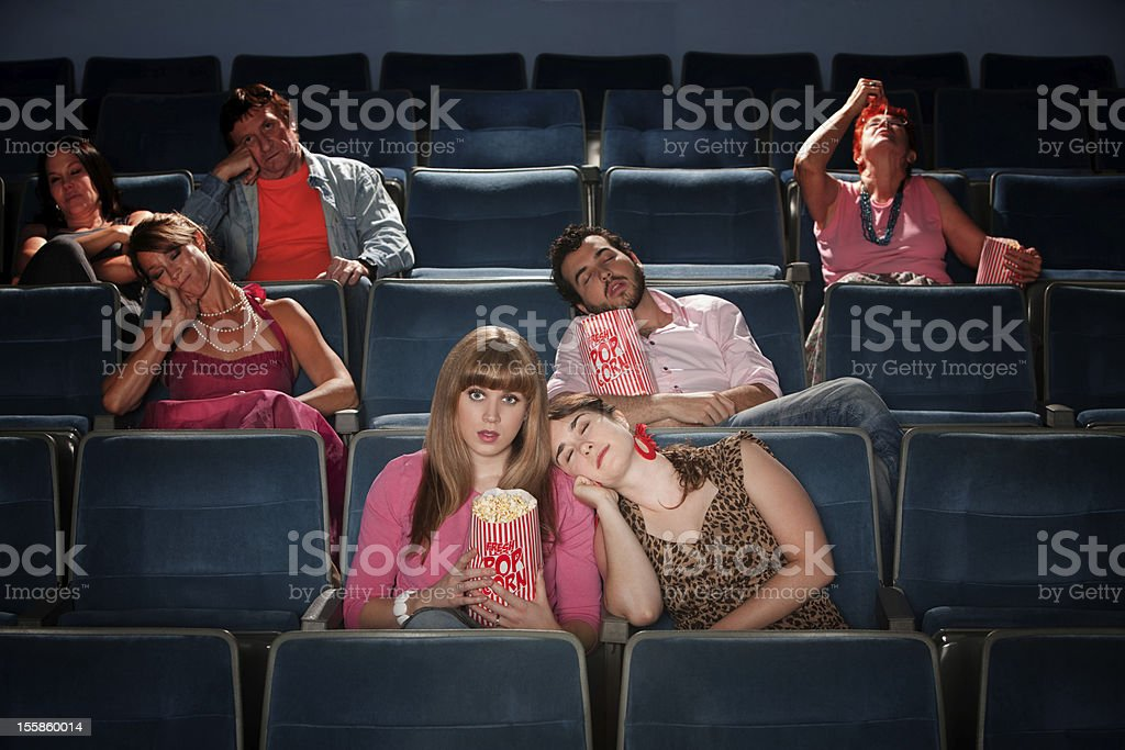 Bored People In Theater stock photo