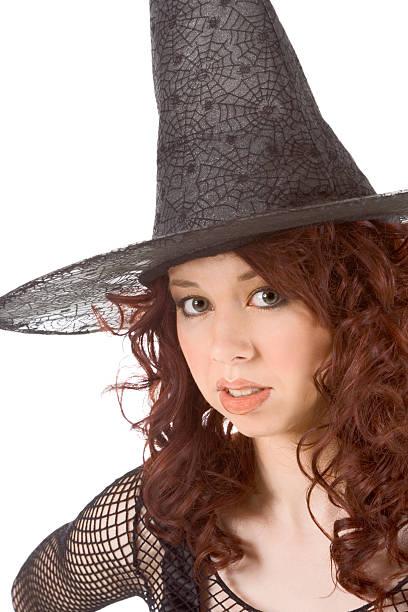 bored read head teen girl in Halloween hat stock photo