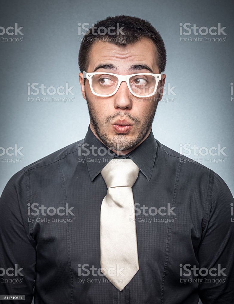 Bored salesman over gray background stock photo