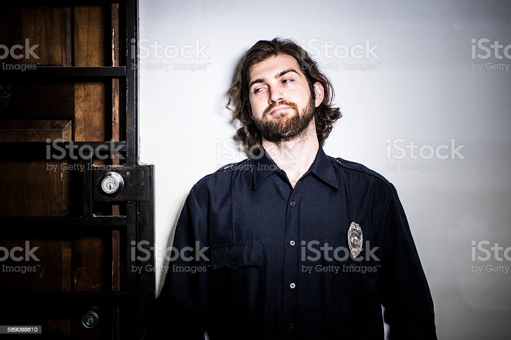 Bored security guard looking askance. stock photo