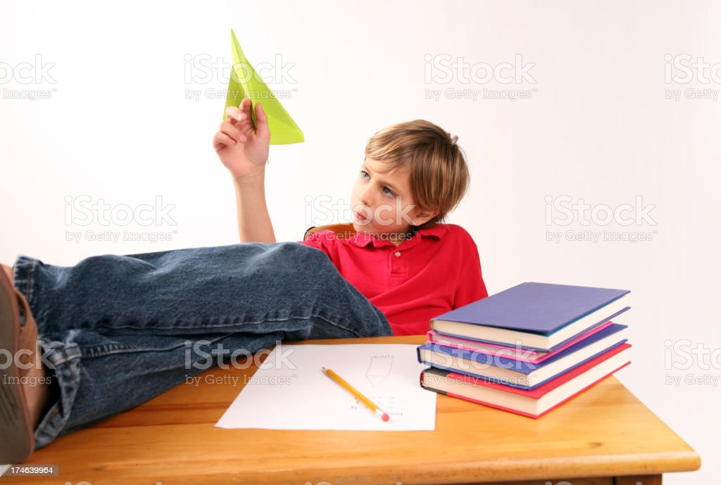 Bored Student playing with Paper Airplane Day Dreaming royalty-free stock photo