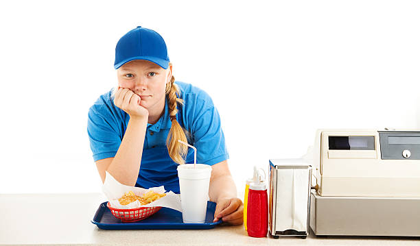bored teen fast food worker - fast food restaurant stock pictures, royalty-free photos & images