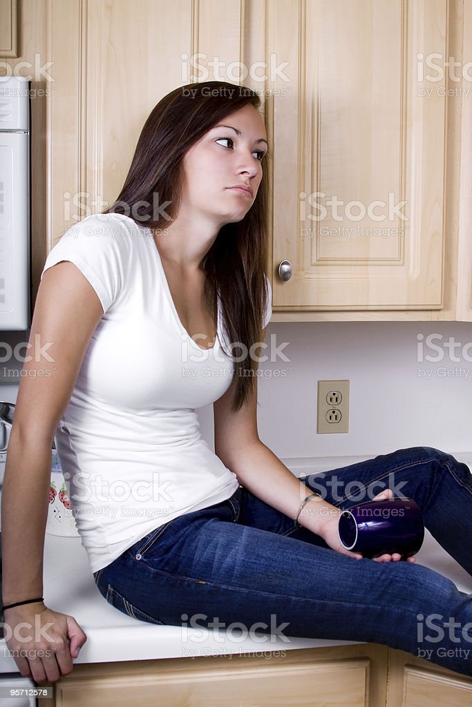 Bored Teenage Girl in the Kitchen royalty-free stock photo