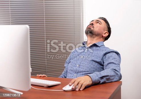 836798276 istock photo bored unhappy mature man using computer 1206213513