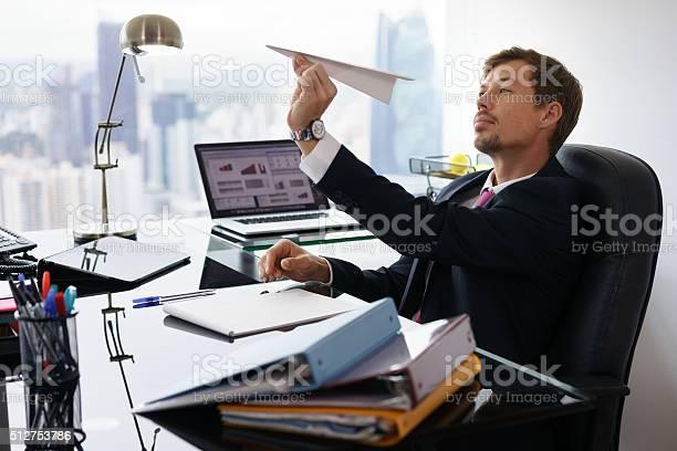 Bored white collar worker throwing paper airplane in office picture id512753786?b=1&k=6&m=512753786&s=612x612&h=hqkc5zu0aol vqxkleck k4xc7va0u7uwqhpmcudzbk=
