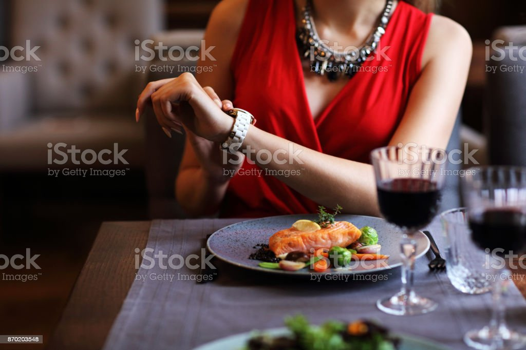 Bored Woman Alone at Restaurant stock photo