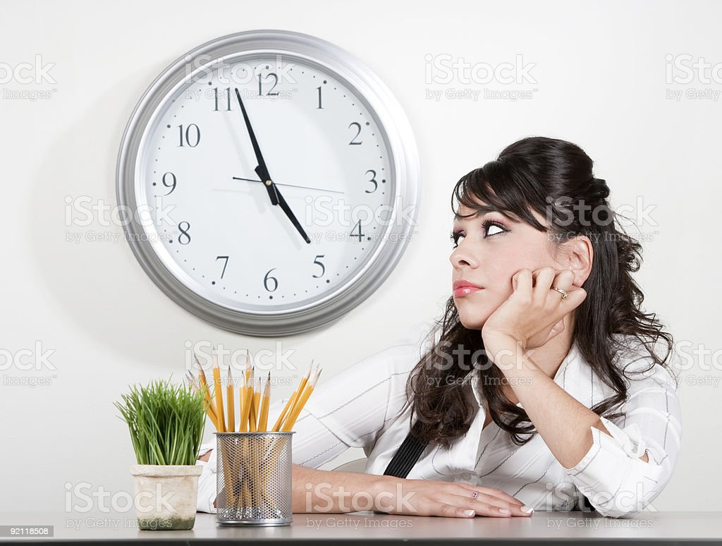 Bored woman at end of day stock photo