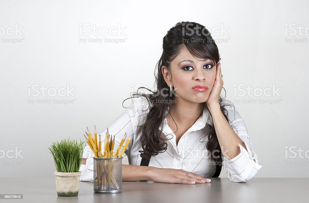 Bored woman at work royalty-free stock photo